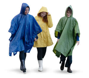 three cut out women in raincoats walking on a rainy day