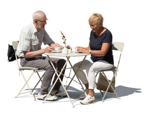 cut out older man and woman sitting in a cafe