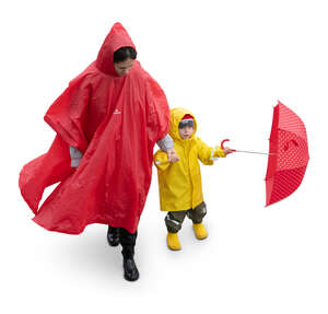 cut out woman with her little son walking in the rain seen from above