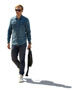 cut out sidelit image of a young man walking