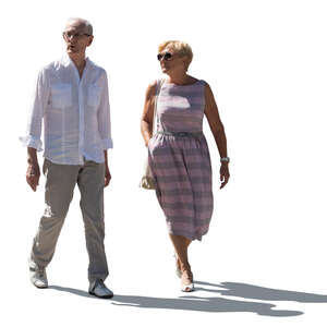 cut out backlit older man and woman walking