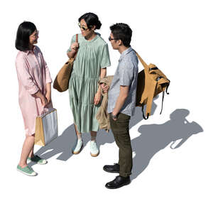 cut out group of three asian people standing and talking