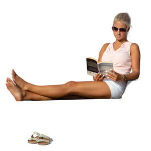 cut out woman lying on a chair and reading a book