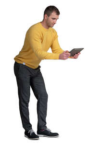 cut out man leaning on a table and looking at a tablet