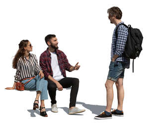 two cut out people sitting and talking to a man standing in front of them