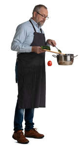 cut out older man cooking