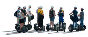 cut out backlit group of people riding segways
