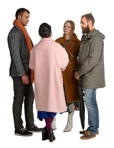 group of people in overcoats standing and talking