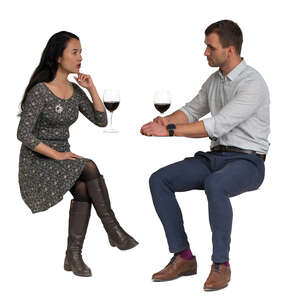 cut out man and woman sitting in a restaurant and drinking wine