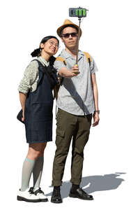 cut out young asian couple standing and taking a selfie