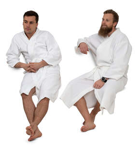 two cut out men in bathrobes sitting in a spa