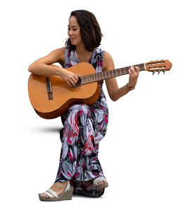 cut out woman sitting and playing a guitar
