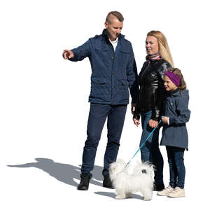 cut out family with a dog standing on a sunny autumn day