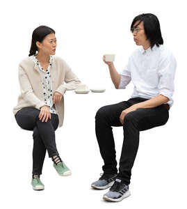 cut out asian man and woman sitting in a cafe and talking