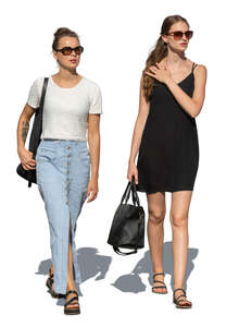 two cut out young women walking