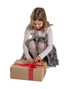cut out little girl squatting and unwrapping a present