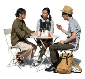 three cut out asian friends sitting in a cafe and talking