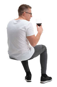 cut out man sitting and drinking wine