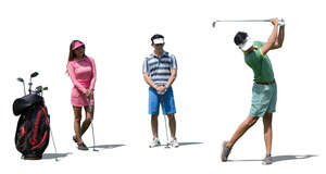 three cut out golfers playing golf at a golf club