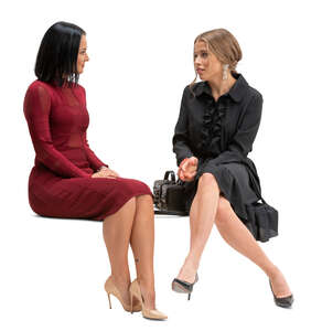 two cut out women sitting and talking