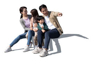 cut out chinese family with two kids sitting and looking at smth
