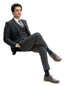 cut out man in a formal black suit sitting
