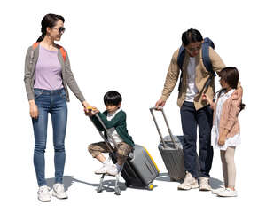 cut out family with two kids and travelling bags standing and talking