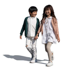 two cut out asian kids walking happily hand in hand