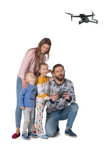 cut out family flying a drone