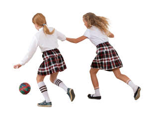 two cut out schoolgirls playing football