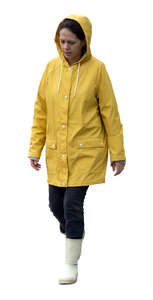 cut out woman in a yellow raincoat walking