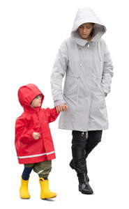 cut out mother and son walking hand in hand on a rainy autumn day