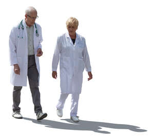 two cut out backlit doctors walking
