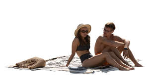 cut out man and woman sitting at the beach and talking