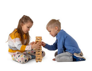 two cut out kids playing on the floor with some wooden toys
