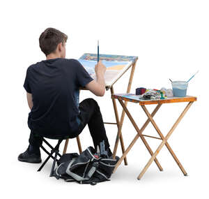 cut out young man sitting and painting