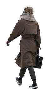 cut out woman in a brown overcoat walking