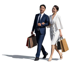 cut out asian couple with shopping bags walking and talking