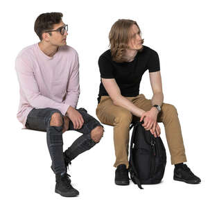 two cut out young men sitting