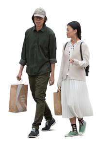 cut out asian man and woman with shopping bags walking and talking