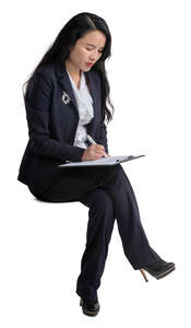 cut out asian businesswoman sitting and taking notes