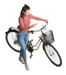 cut out woman with a bicycle standing seen from above