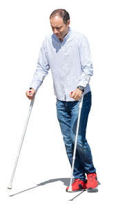 cut out man walking with crutches