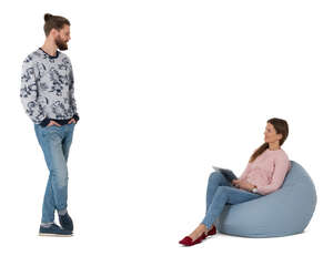 cut out woman sitting in a bean bag talking to a man standing next to her