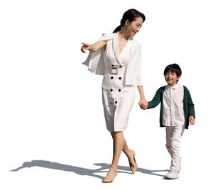 cut out chinese mother and son walking on a sunny summer day