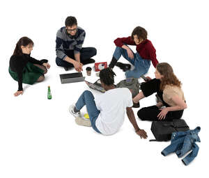 cut out group of college student sitting on the gorund and studying