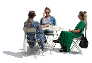 three cut out women sitting in a cafe and talking