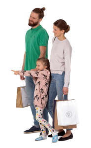 cut out family with shopping bags standing and pointing at smth