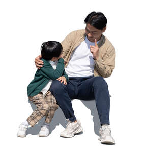 cut out asian father and son sitting and talking