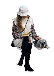 cut out woman with a dog sitting and reading a book